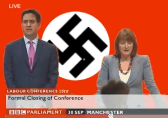 Miliband_and_Harman_in_front_of_swastika